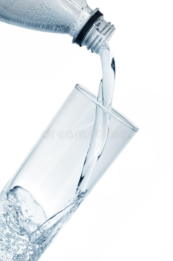 Mineral water in glass. Isolated on a white royalty free stock images