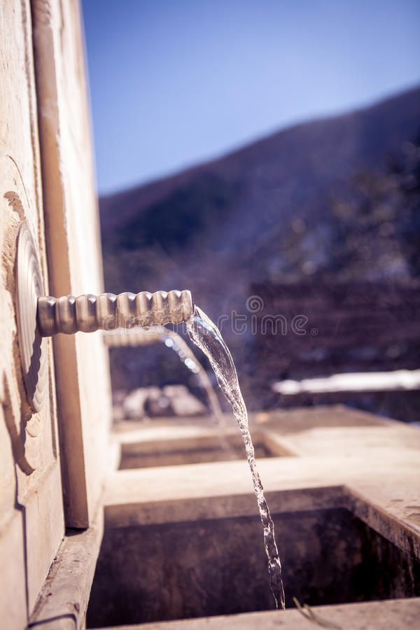 Mineral water spring fountain stock photos