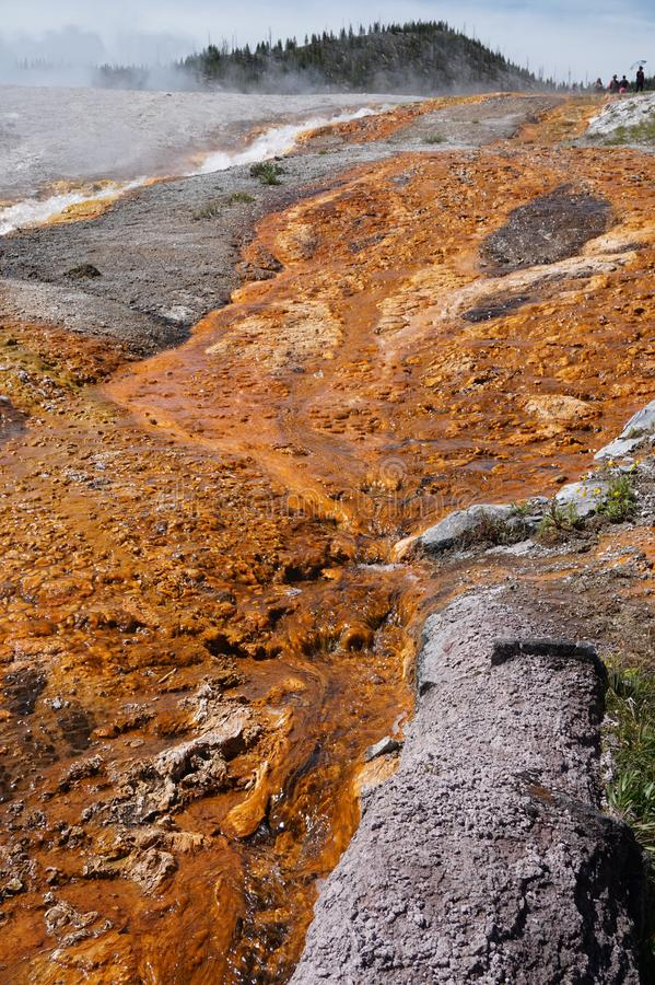 Solidified rust colored mineral deposits. Among the geyser vapors and run-offs at Yellowstone National Park, USA royalty free stock image