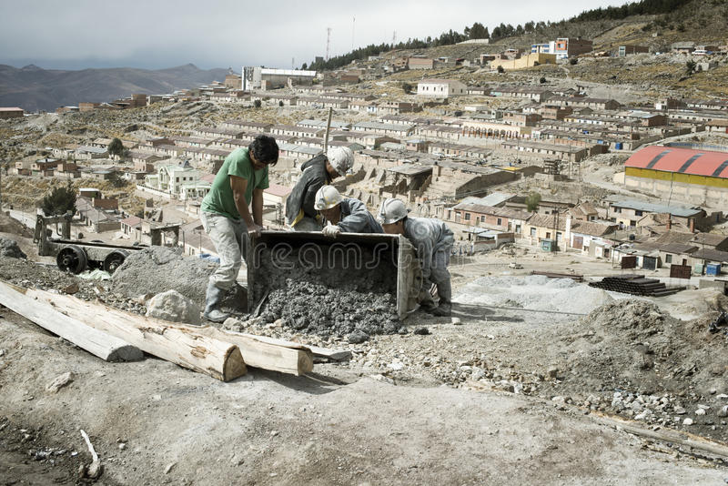 Miners emptying mine cart at Cerro Rico silver mine in Potosi stock photos