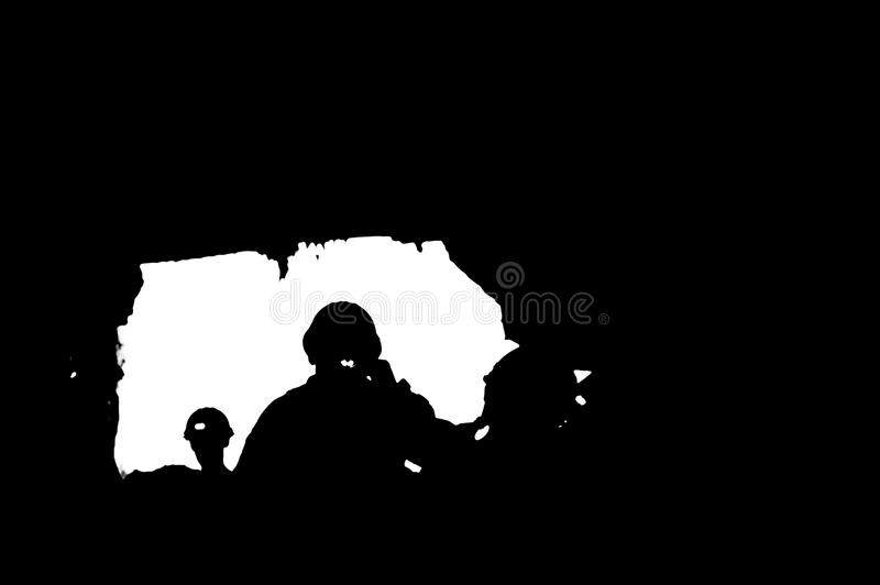 Miners with headlamp silhouette. Silhouette of Miners with headlamp in cave royalty free stock photo