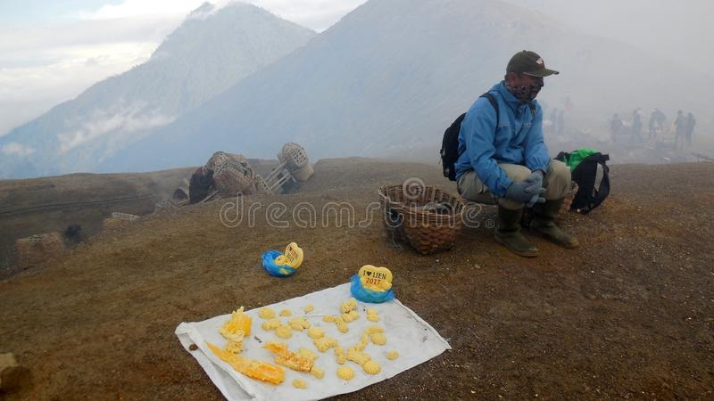 The Miners of sulfur from Mount Ijen crater stock photography