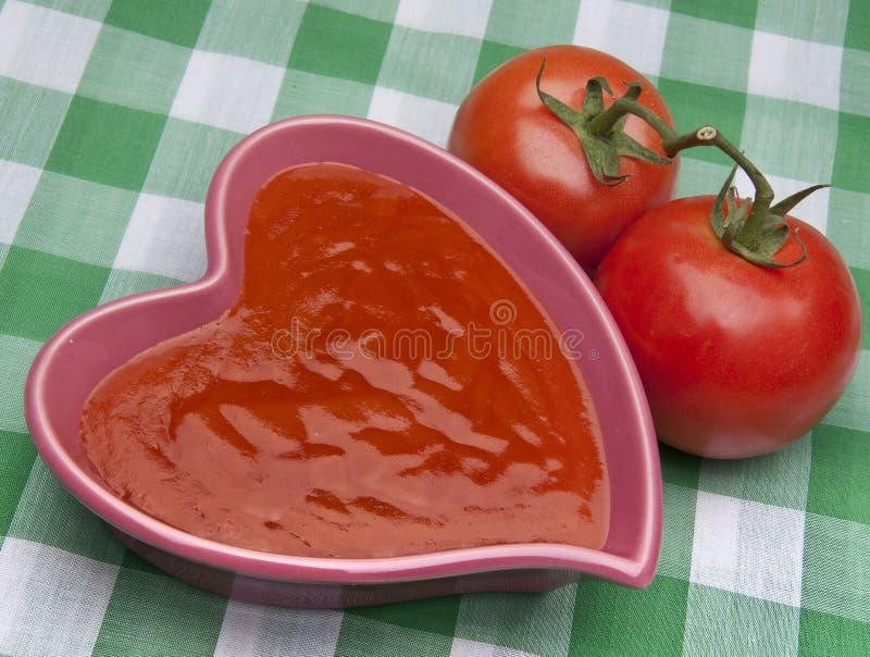 Minestra sana del pomodoro del cuore immagini stock
