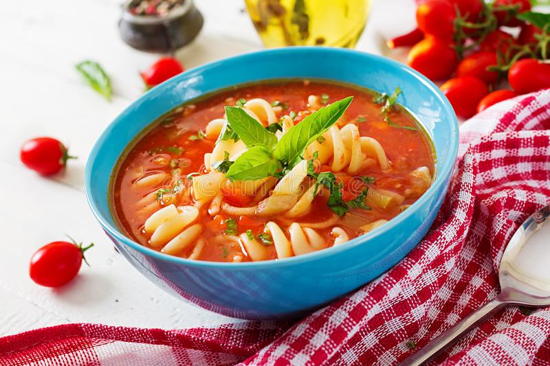 Minestrone, italian vegetable soup with pasta. Tomatoes soup. Vegan food stock photography