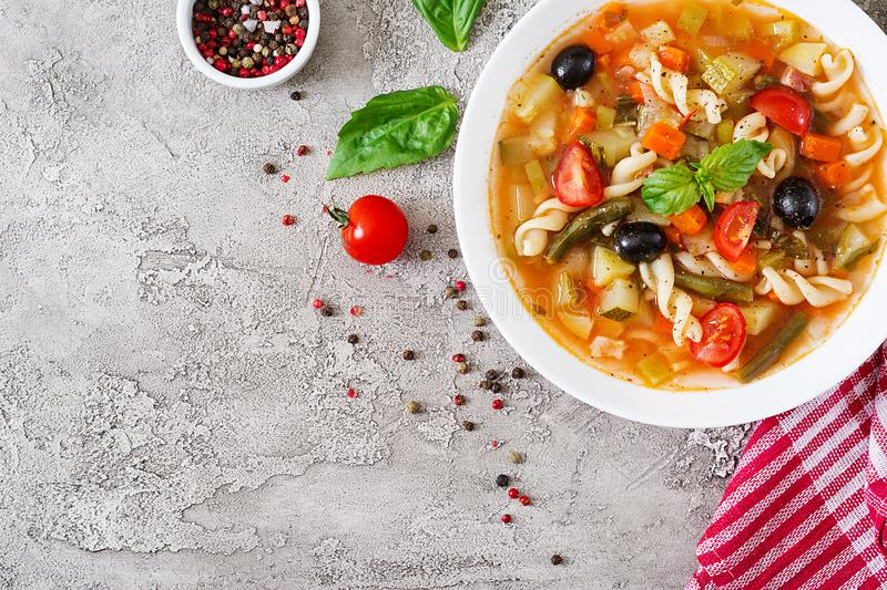 Minestrone, italian vegetable soup with pasta. Vegan food. Top view. Flat lay stock photo
