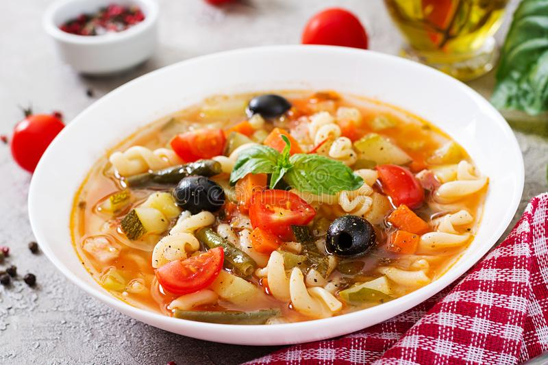 Minestrone, italian vegetable soup with pasta. Vegan food. Minestrone, italian vegetable tasty soup with pasta. Vegan food royalty free stock images