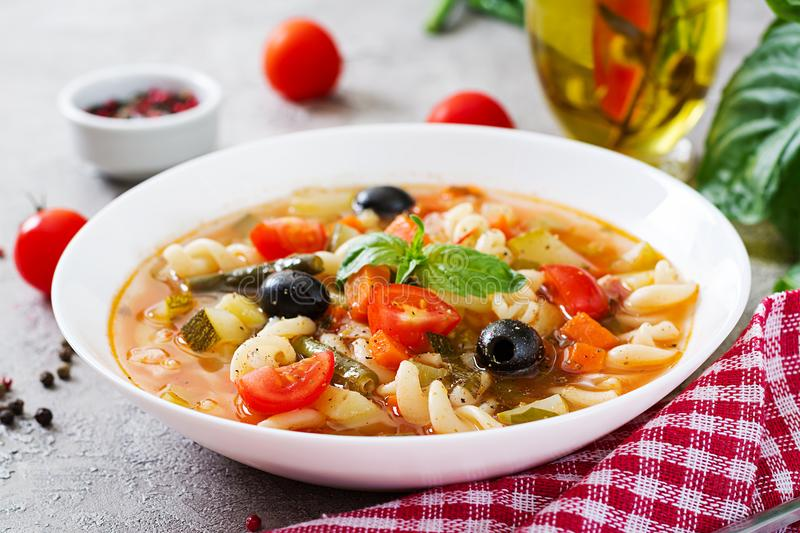 Minestrone, italian vegetable soup with pasta. Vegan food. Minestrone, italian vegetable tasty soup with pasta. Vegan food royalty free stock image