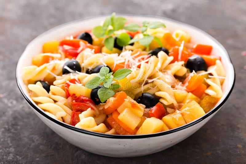 Minestrone, italian vegetarian soup with pasta and vegetables stock photo