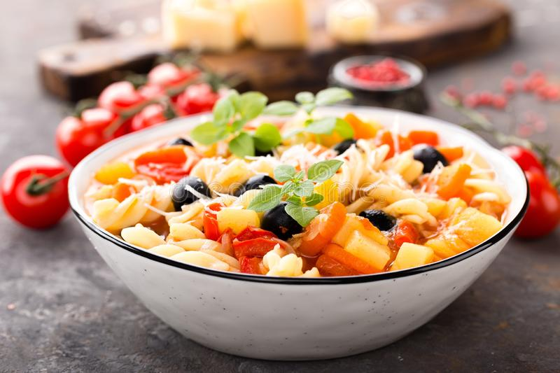 Minestrone, italian vegetarian soup with pasta and vegetables stock photos