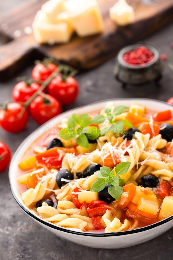 Minestrone, italian vegetarian soup with pasta and vegetables royalty free stock photo