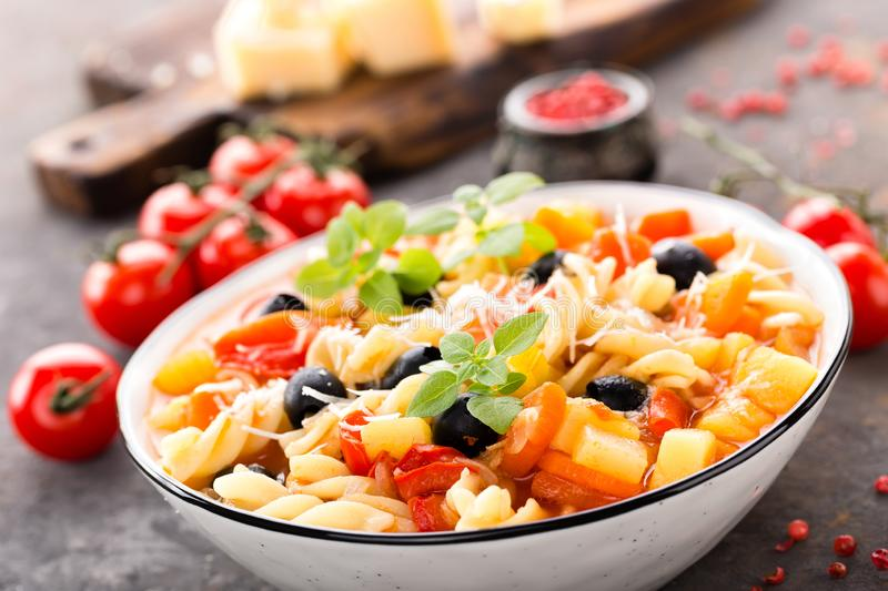 Minestrone, italian vegetarian soup with pasta and vegetables stock image