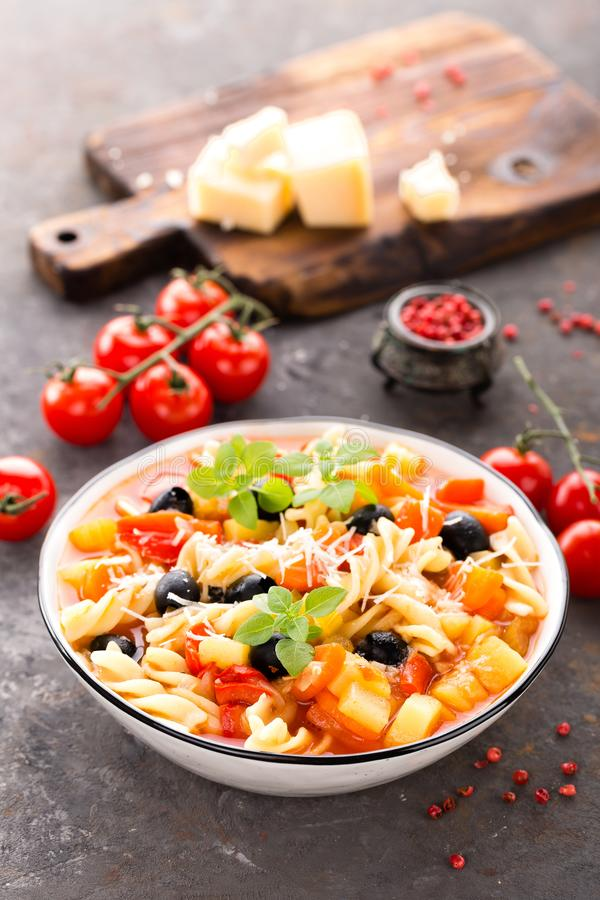 Minestrone, italian vegetarian soup with pasta and vegetables royalty free stock photos