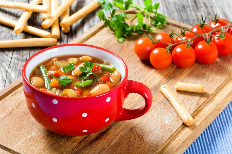 Minestrone vegetable soup with beans, cauliflower, tomatoes, close-up, top view.  stock photos