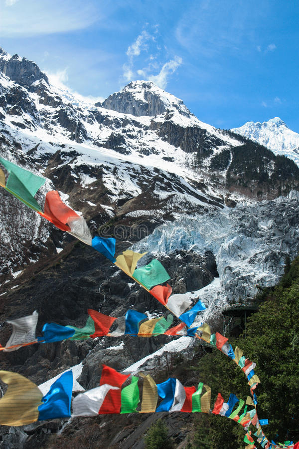 Ming yong glacier with buddhist prayer flags stock photography