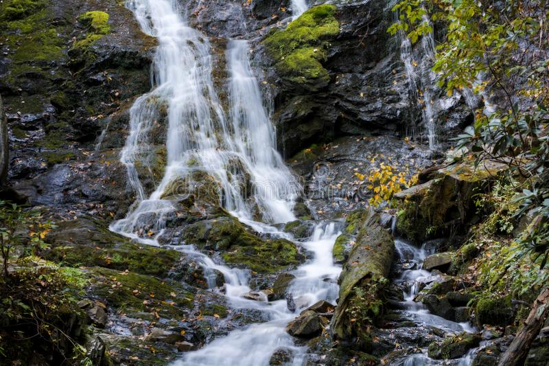 Mingo Falls Waterfall. A portion of Mingo Falls. It`s a scenic 150 foot waterfall not far from the Blue Ridge Parkway in Cherokee North Carolina.Seen here in stock photos
