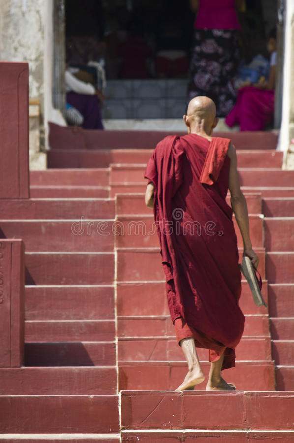 The Mingun Pahtodawgyi and a monk royalty free stock photography