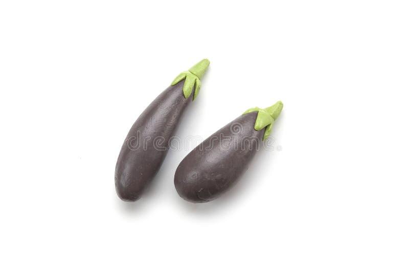 Mini- auberginemodell från lera royaltyfri foto
