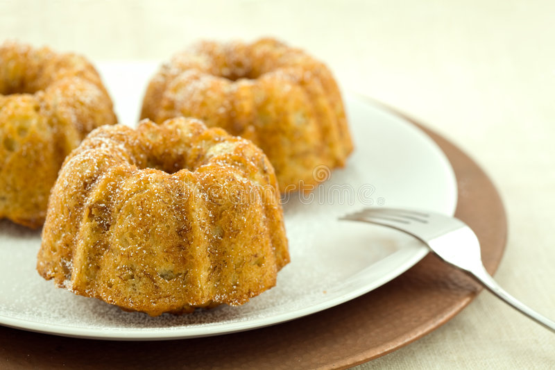 Download Mini Banana Bundt Cakes stock photo. Image of yellow, plate - 4051470