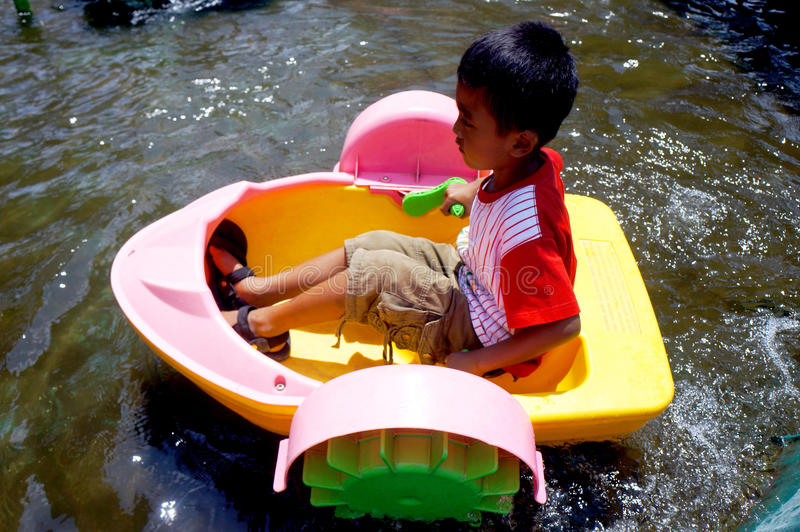 Mini boat. Children play mini boat in a playground in the city of Solo, Central Java, Indonesia stock images