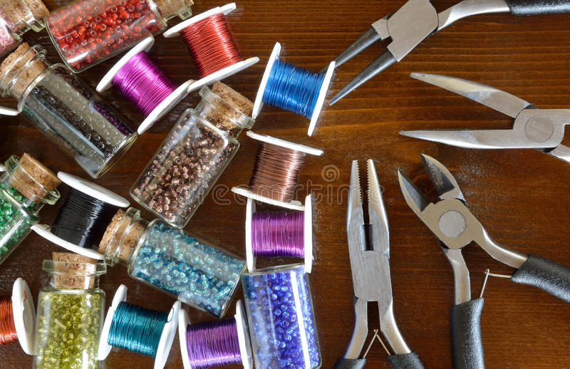 Mini bottles with beads, wire crafts and pliers stock photography