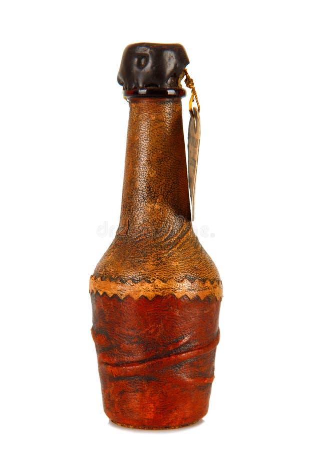 Mini bouteille couverte en cuir images libres de droits