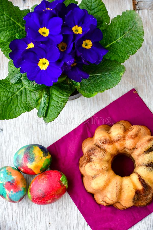 Bundt easter marble cake, easter eggs and Primrose - Primula vulgaris stock photo