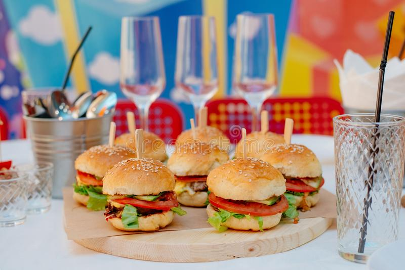 Mini burgers for a party stock images