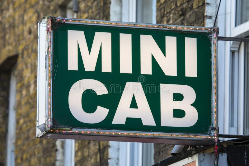 Mini Cab Sign arkivbild