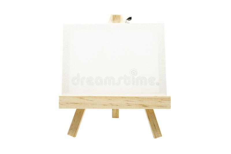 Mini caballete de madera con el marco en blanco de la lona aislado fotos de archivo