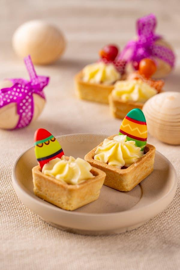 Mini cakes with fresh vanilla cream stock image