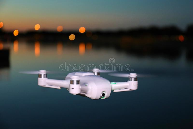 Small Camera Drone Flying (Evening Picture) stock image