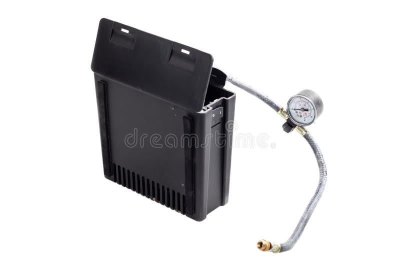 Mini car air compressor on white background stock photo