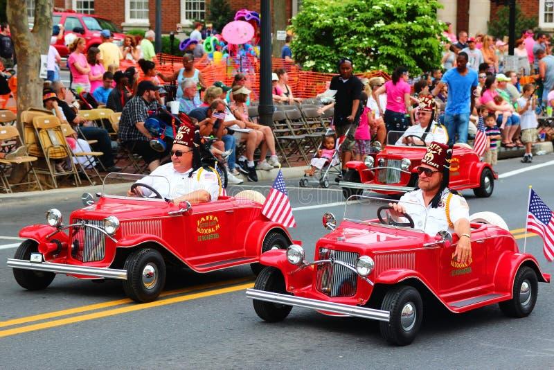 Mini Car Riders in Parade royalty free stock image