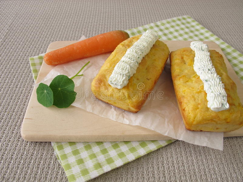 Mini carrot bread with herb cream cheese stock photography