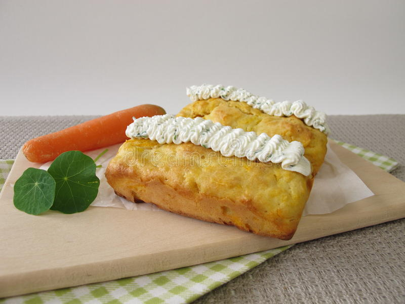 Mini carrot bread with herb cream cheese stock photo