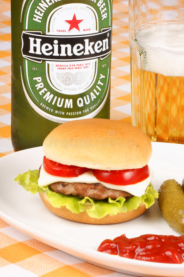 Mini cheese burger, beer and pickles stock image
