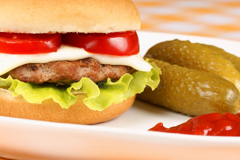 Mini cheese burger and pickles royalty free stock photography