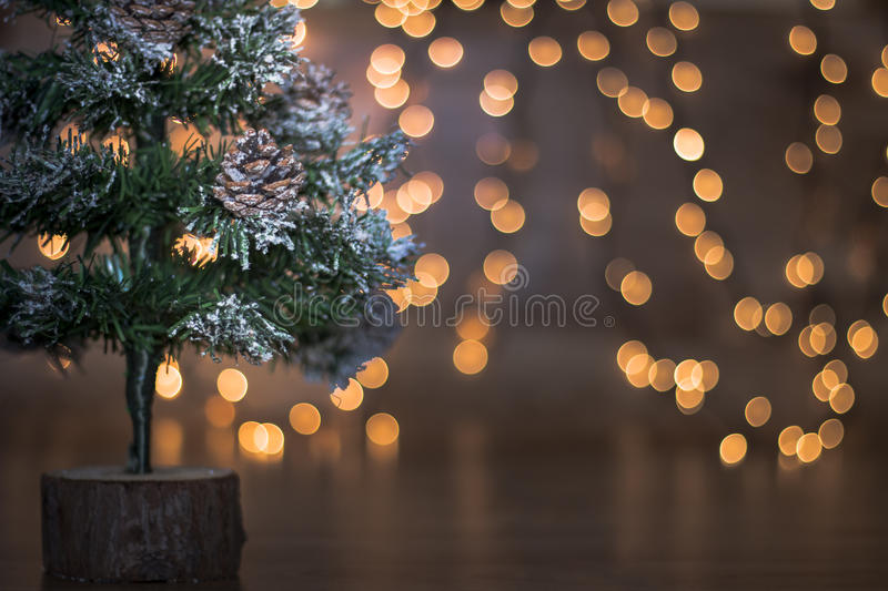 Mini Christmas tree with lights and wood background royalty free stock photo