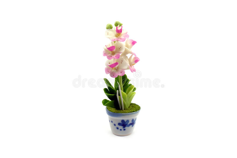 Mini clay flower in the pot royalty free stock images
