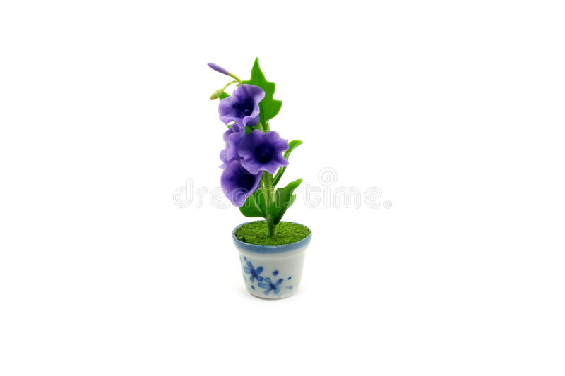 Mini clay flower in the pot royalty free stock image