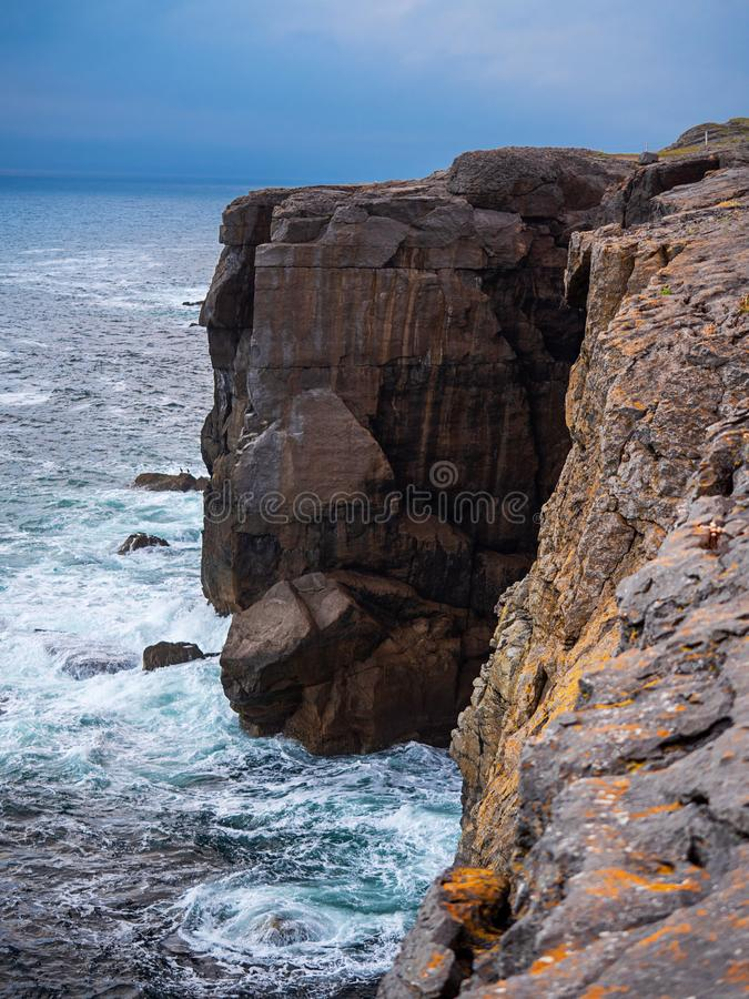 Mini cliffs in county Clare, Ireland, Atlantic ocean, blue sky, Vertical image royalty free stock images