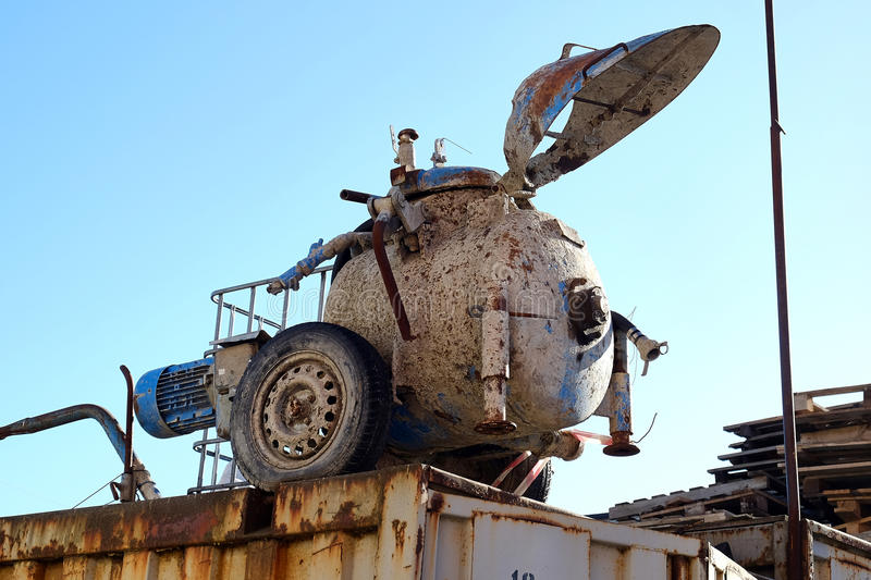 Mini concrete mixer. Is on the roof of the garage royalty free stock images