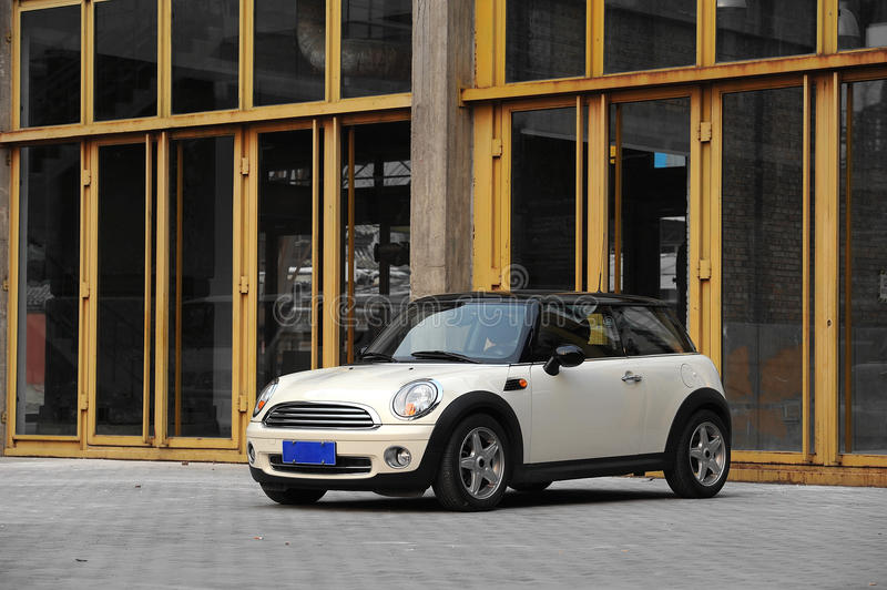 Mini Cooper. Fun, a unique car with classical design. Shot at an old factory stock photo