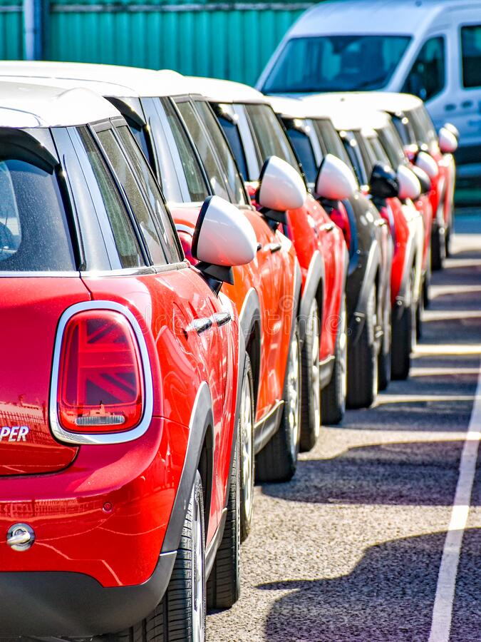 MINI Cooper cars are ready for shipment in a row in the port of Southampton United Kingdom. Southampton, United Kingdom – August 6, 2018: MINI Cooper cars royalty free stock photography