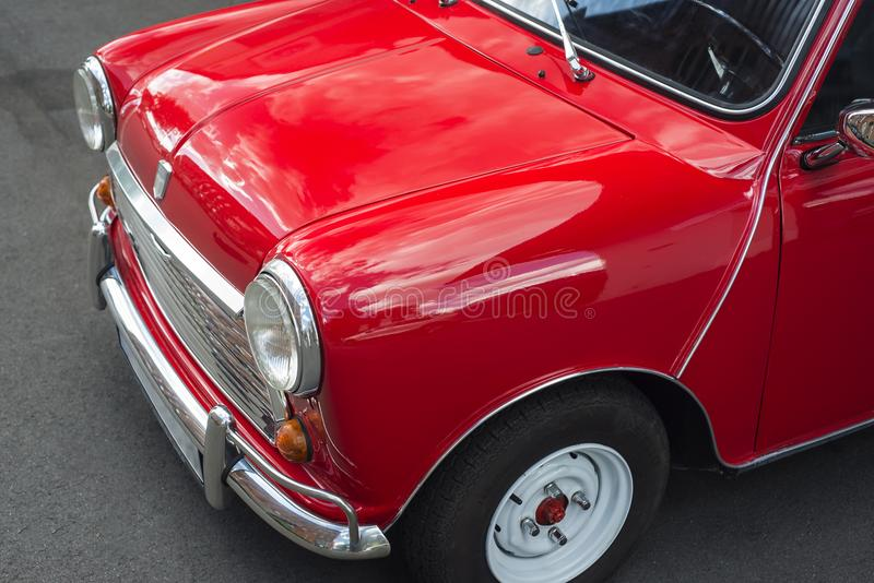 Mini Cooper. Vintage car in red with white roof stock images