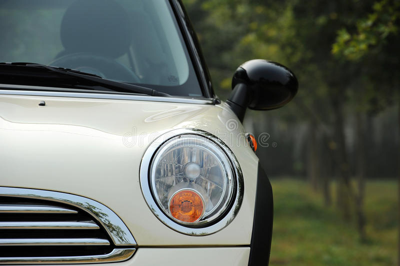 Mini Cooper,Part. Mini cooper fun, a unique car with classical design. Part of front view royalty free stock image