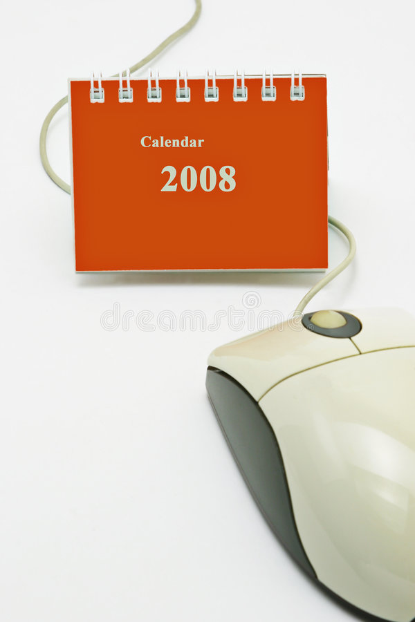 Mini desktop calendar and computer mouse stock image