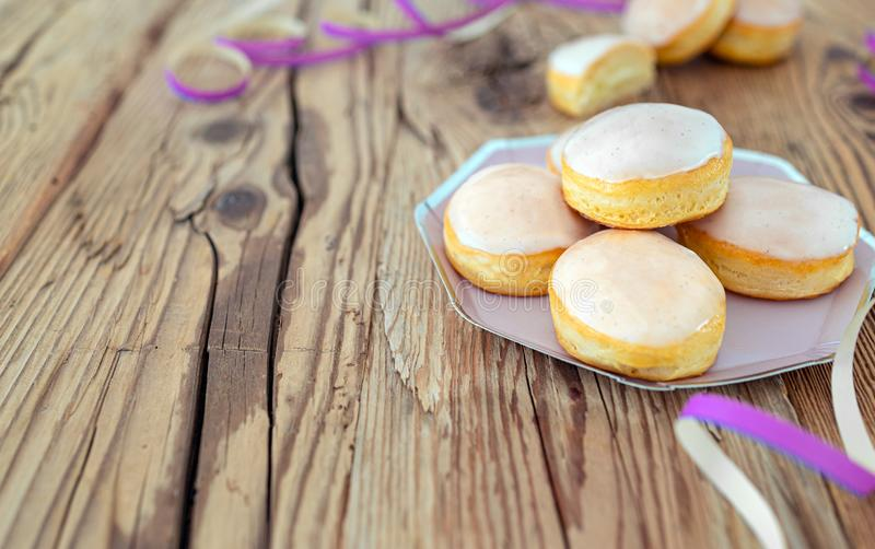 Mini doughnuts glazed with frosting and pink streamers stock images