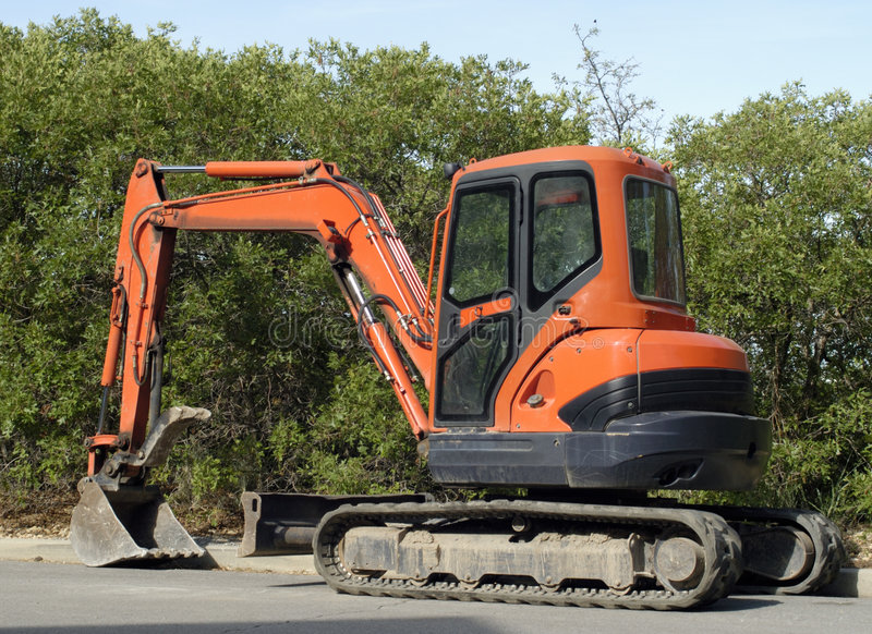 Mini excavator from back royalty free stock images