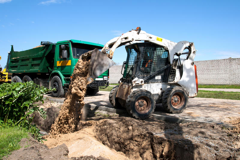 Mini excavator at construction site royalty free stock photography